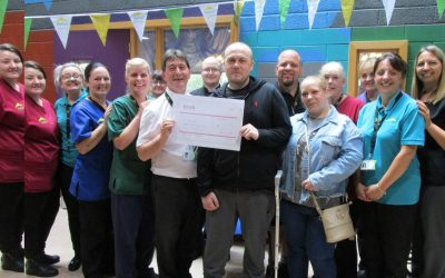 Colleagues smash fundraising target for team member